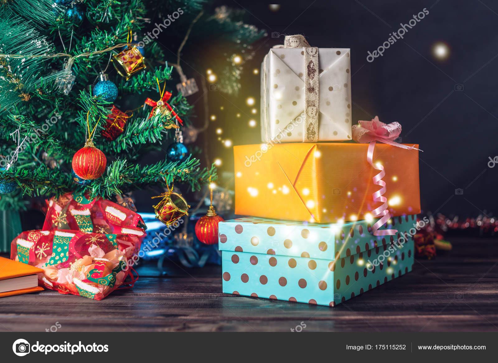 Family gift box from Santa Claus near the Christmas tree on ...