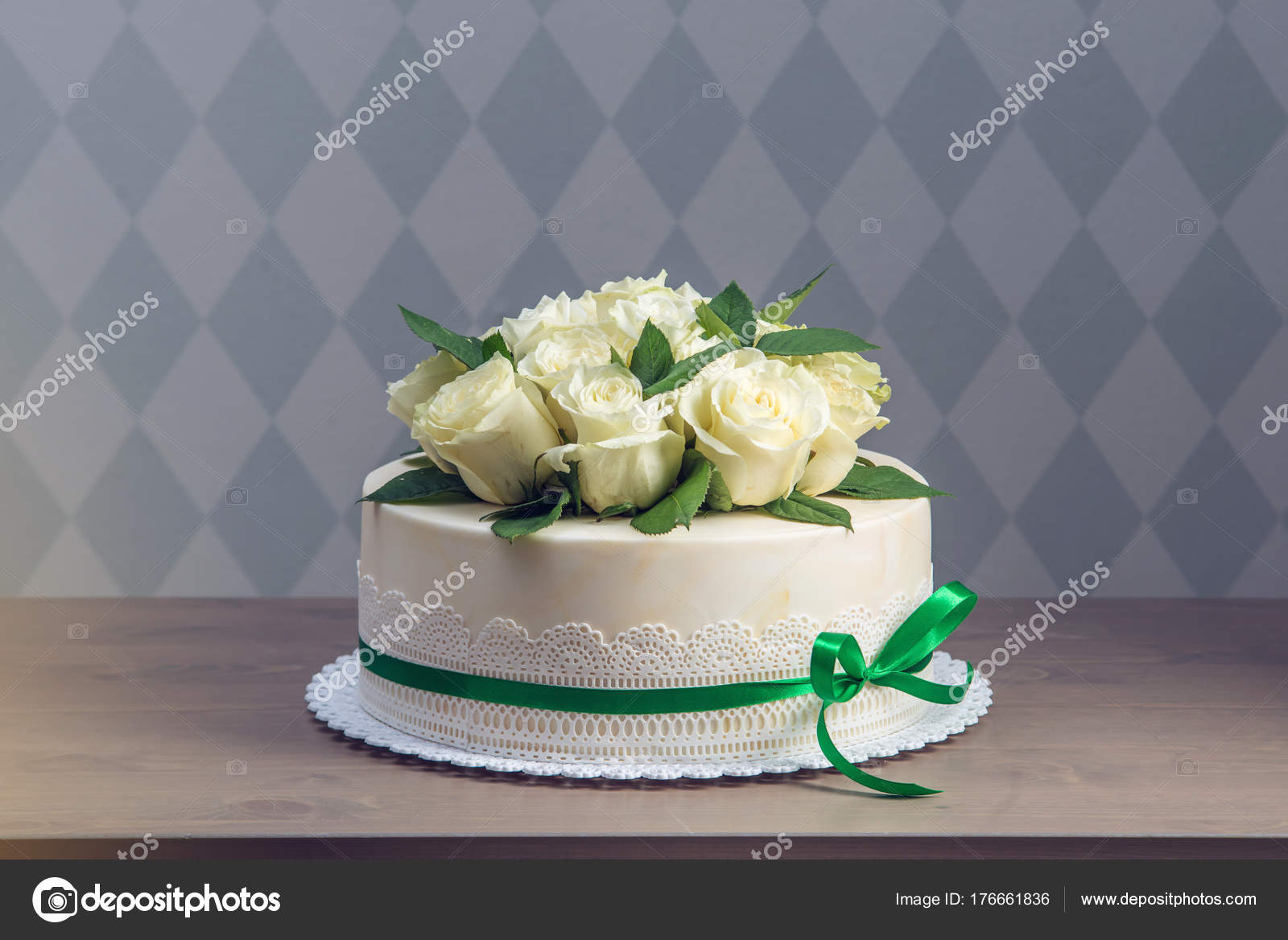 Beautiful White Wedding Cake Decorated With Bouquet Of Flowers White