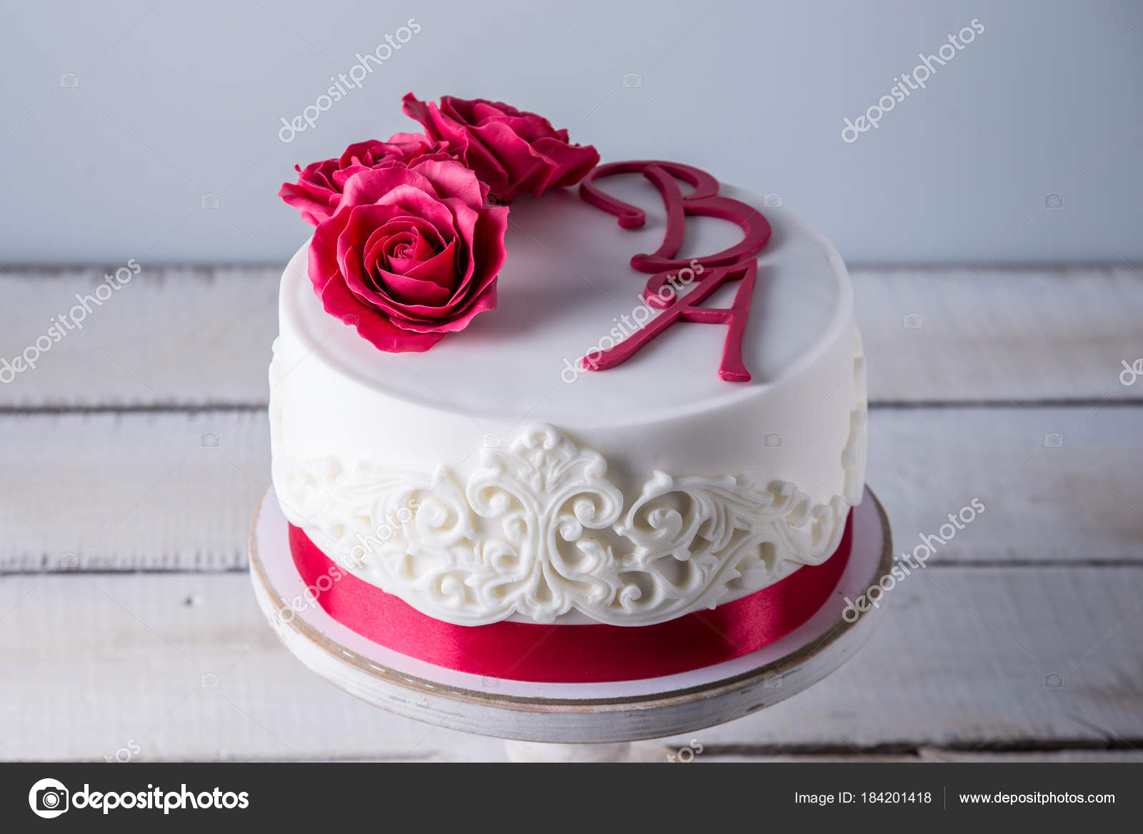 Beautiful White Wedding Cake Decorated With Flowers Red Roses And Ribbon Concept Of Elegant Holiday Desserts Stock Image