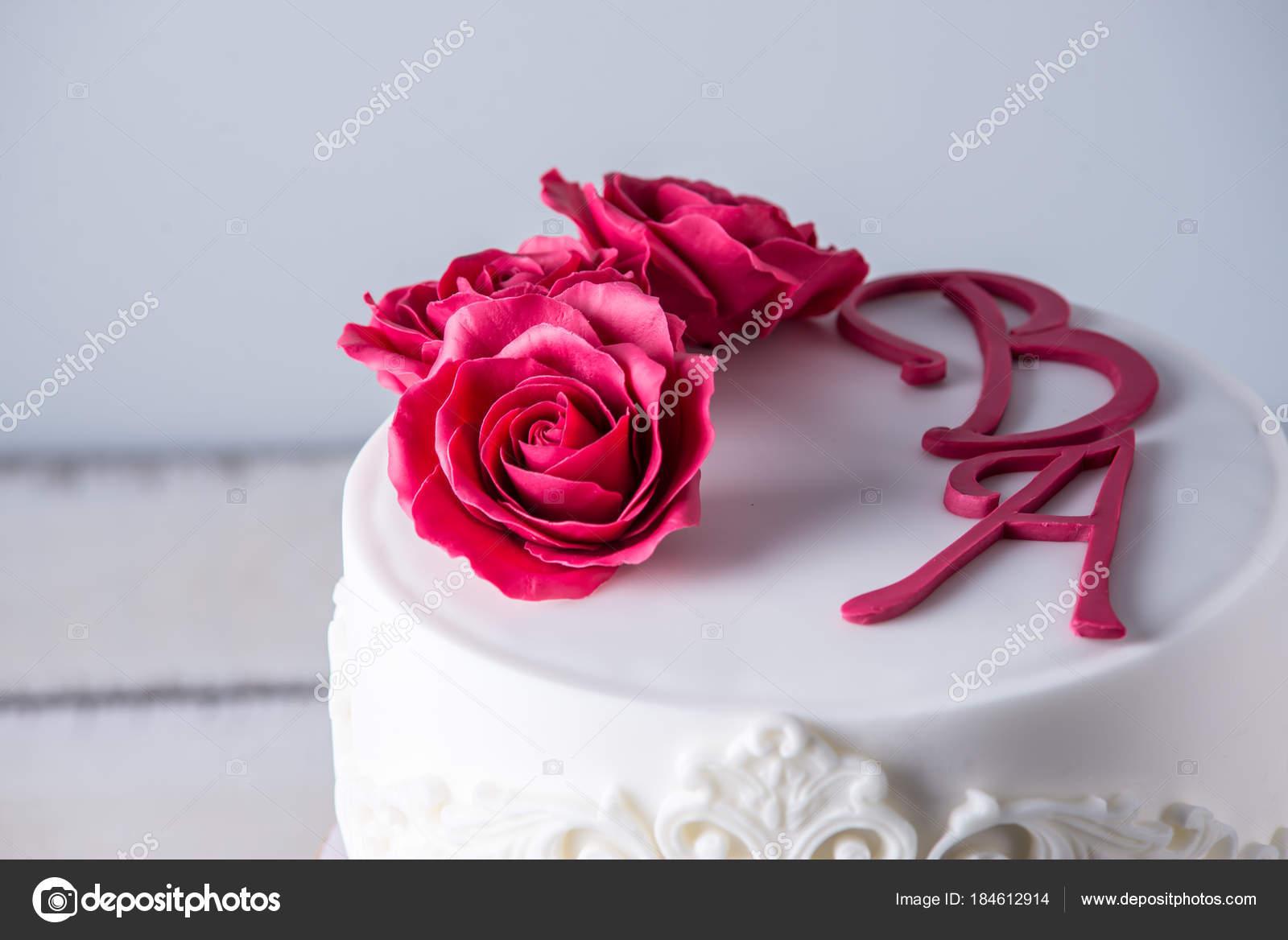 Beautiful white wedding cake decorated with flowers red roses and beautiful white wedding cake decorated with flowers red roses and ribbon concept of elegant holiday izmirmasajfo