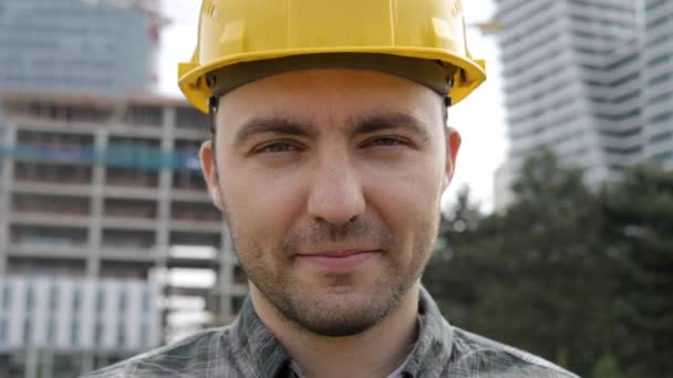 Young businessman construction site engineer looking to camera.