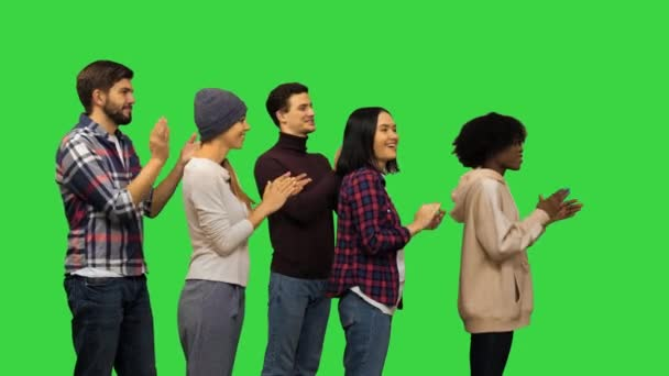 Happy young people clapping hands on a Green Screen, Chroma Key.