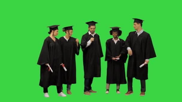 Happy friends graduates join hands together The concept of a friendly team on a Green Screen, Chroma Key.