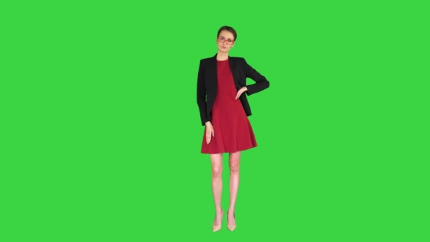 Young fashionable woman with folded hand on a Green Screen, Chroma Key.