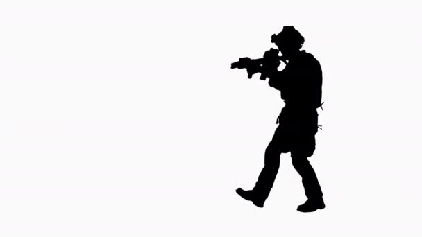 Silhouette Soldier walking aiming with rifle and using radio.