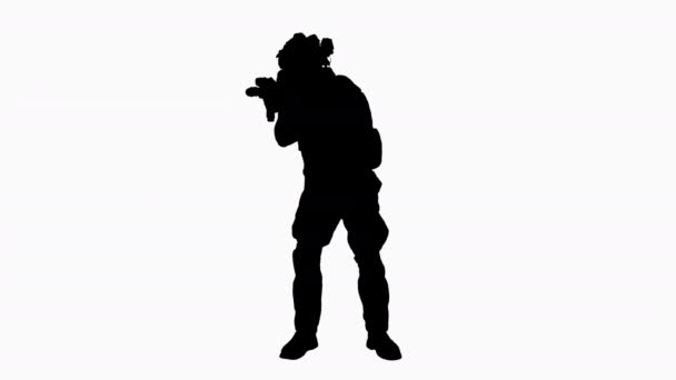 Silhouette Army soldier standing his ground aiming with assault rifle.