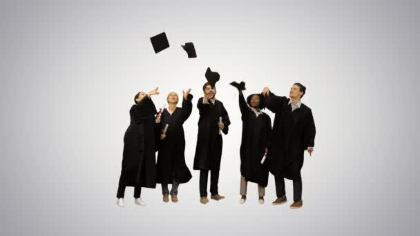 Graduation Caps Are Tossed Into The Air By A Happy Group Of Student Friends on gradient background.