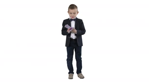 Little boy in a suit counting money on white background.