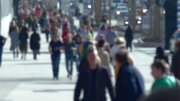 Anonymous crowd of people walking on street slow motion