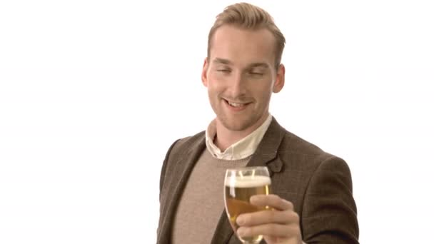 Smiling man with beer glass cheering