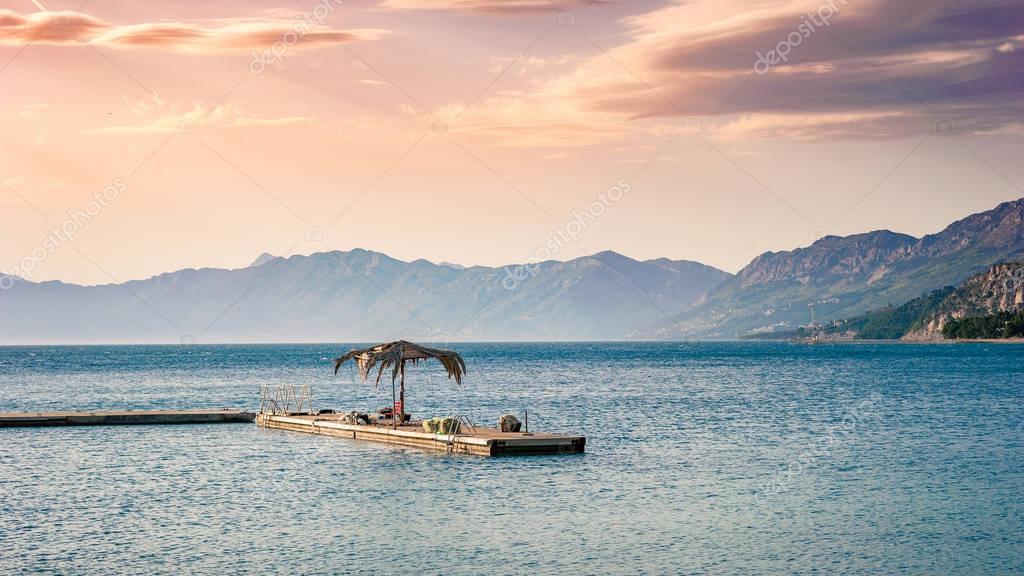 Coast, sea and beach below the mountain Biokovo in the town of Makarska in Croatia