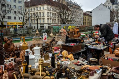 Every Saturday is a flea market at Naschmarkt area in Vienna. Local people and lots of tourists visit the market and looking for bargains and antique stuff.