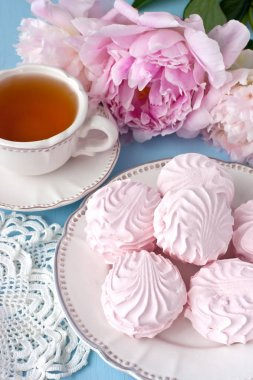 Summer  composition with tea cup and peonies  flowers