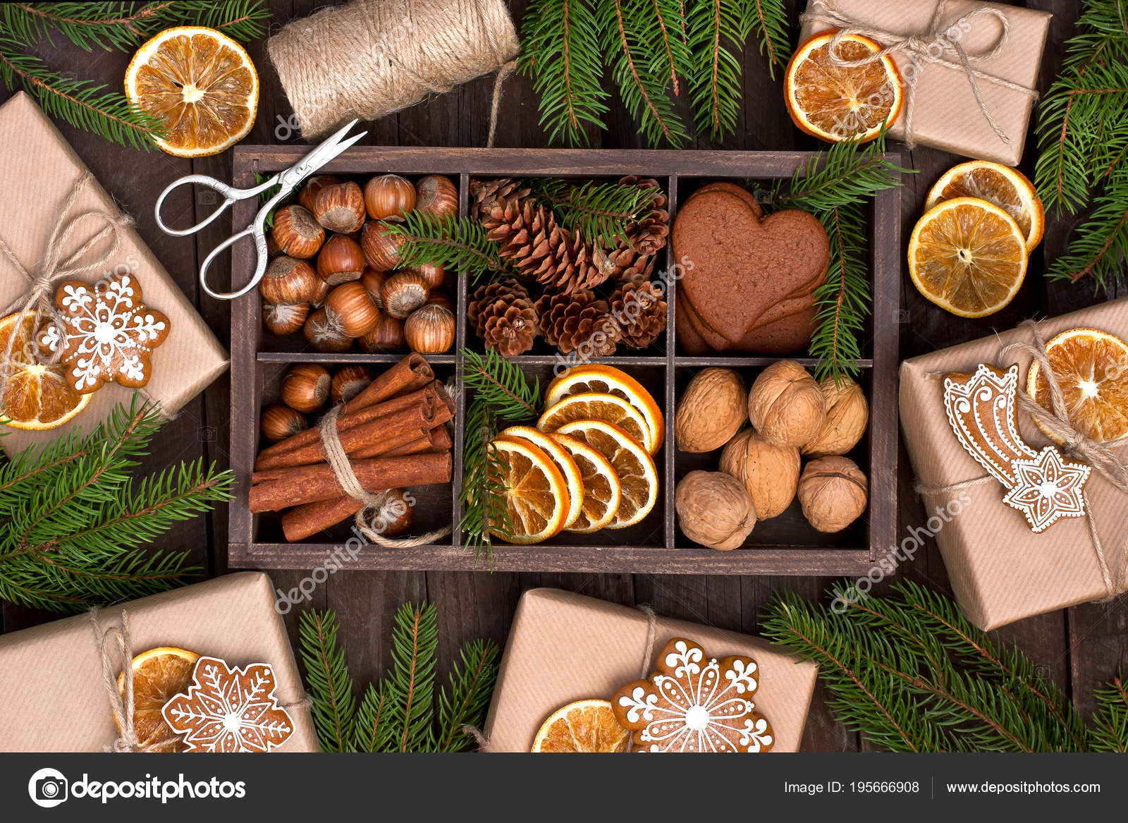 Christmas gift box, food decor and fir tree branch on wooden tab ...