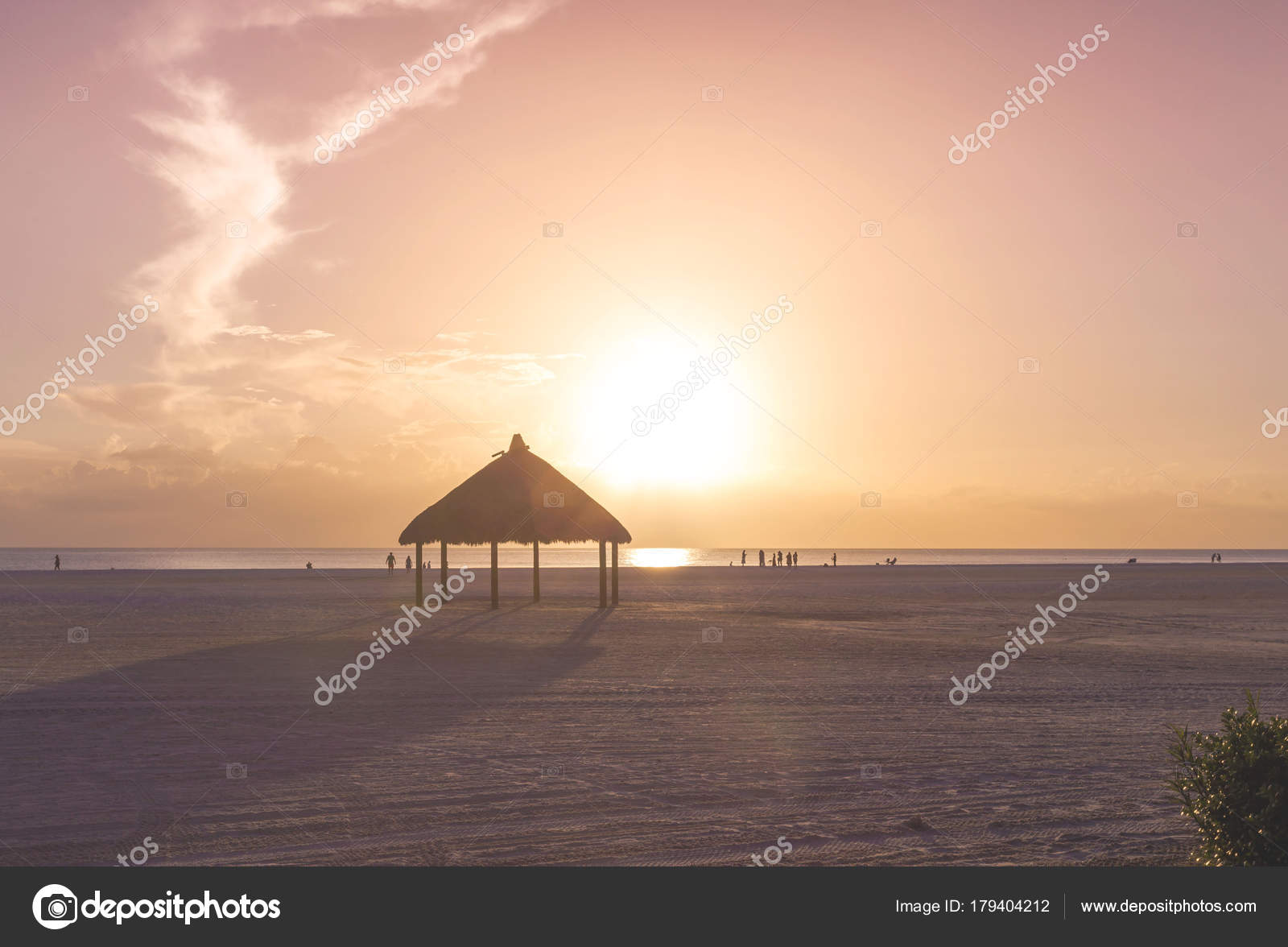 Amazing Sunset At Long Extension Beaches Of Marco Island Beach Gulf Mexico Florida USA With Relaxing Palm Thatch And Calmed Sea The