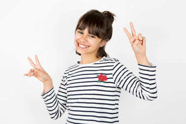 Little girl making victory sign with fingers