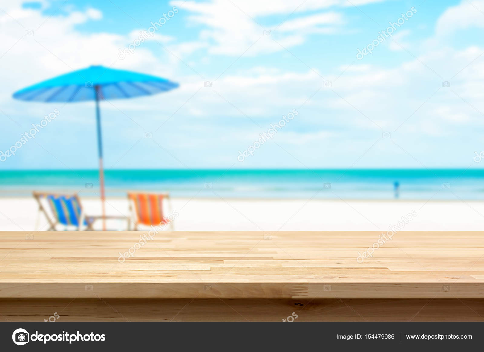 wood table top on blur white sand beach background summer