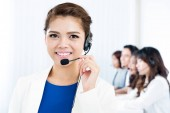 Smiling Asian woman with headphone as an operator