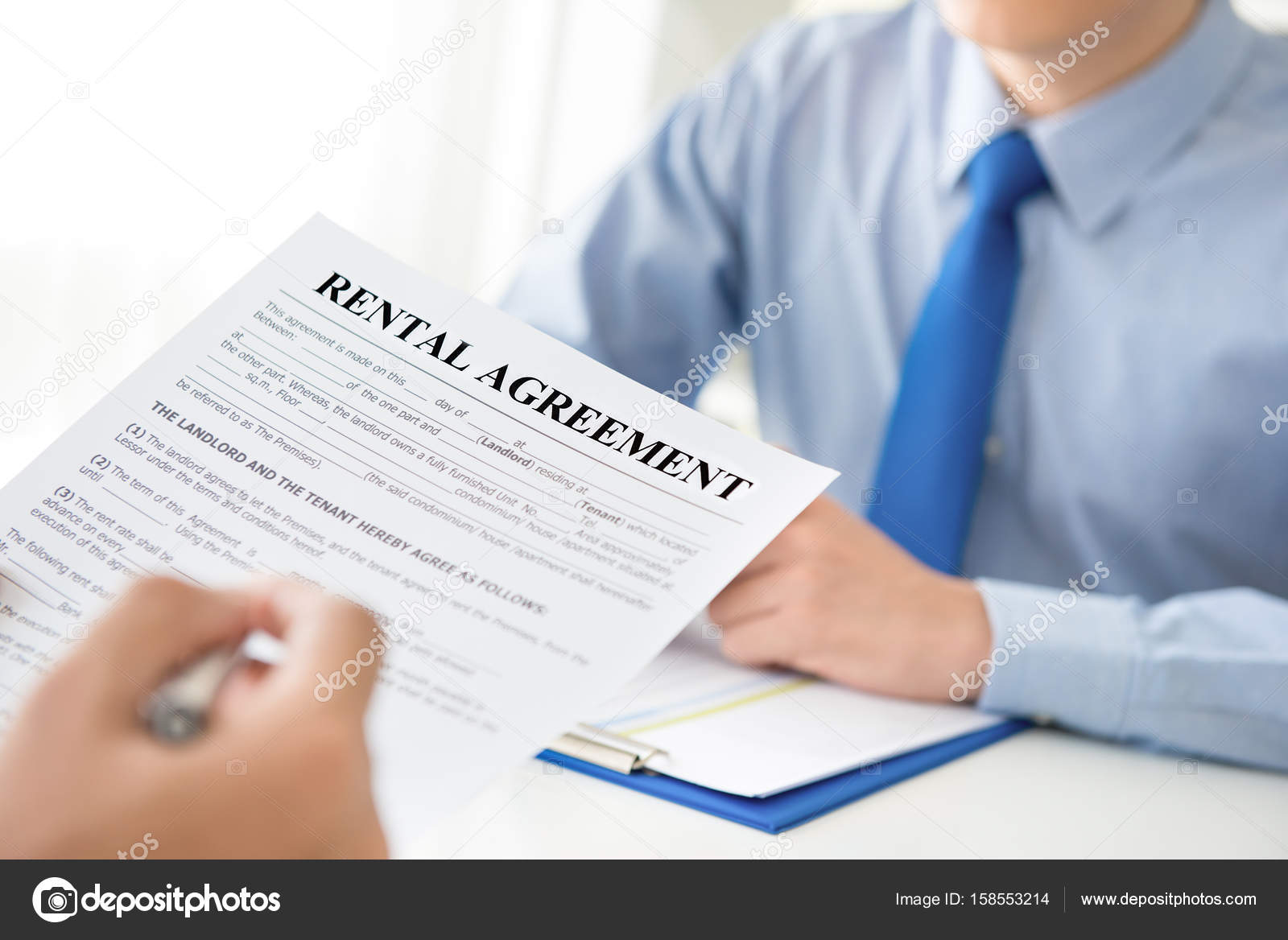 A Man Reading Lease Agreement Paper Stock Photo C Kritchanut
