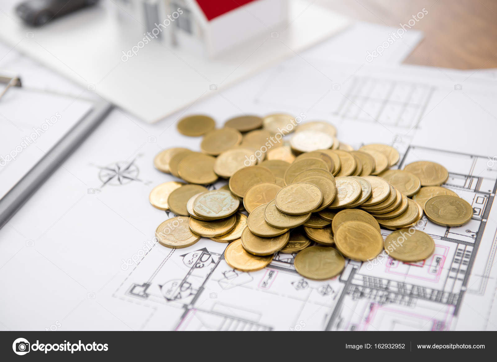 Money on blueprint paper with blurred house model in background money on blueprint paper with blurred house model in background real estate loan and financial concepts photo by kritchanut malvernweather Image collections