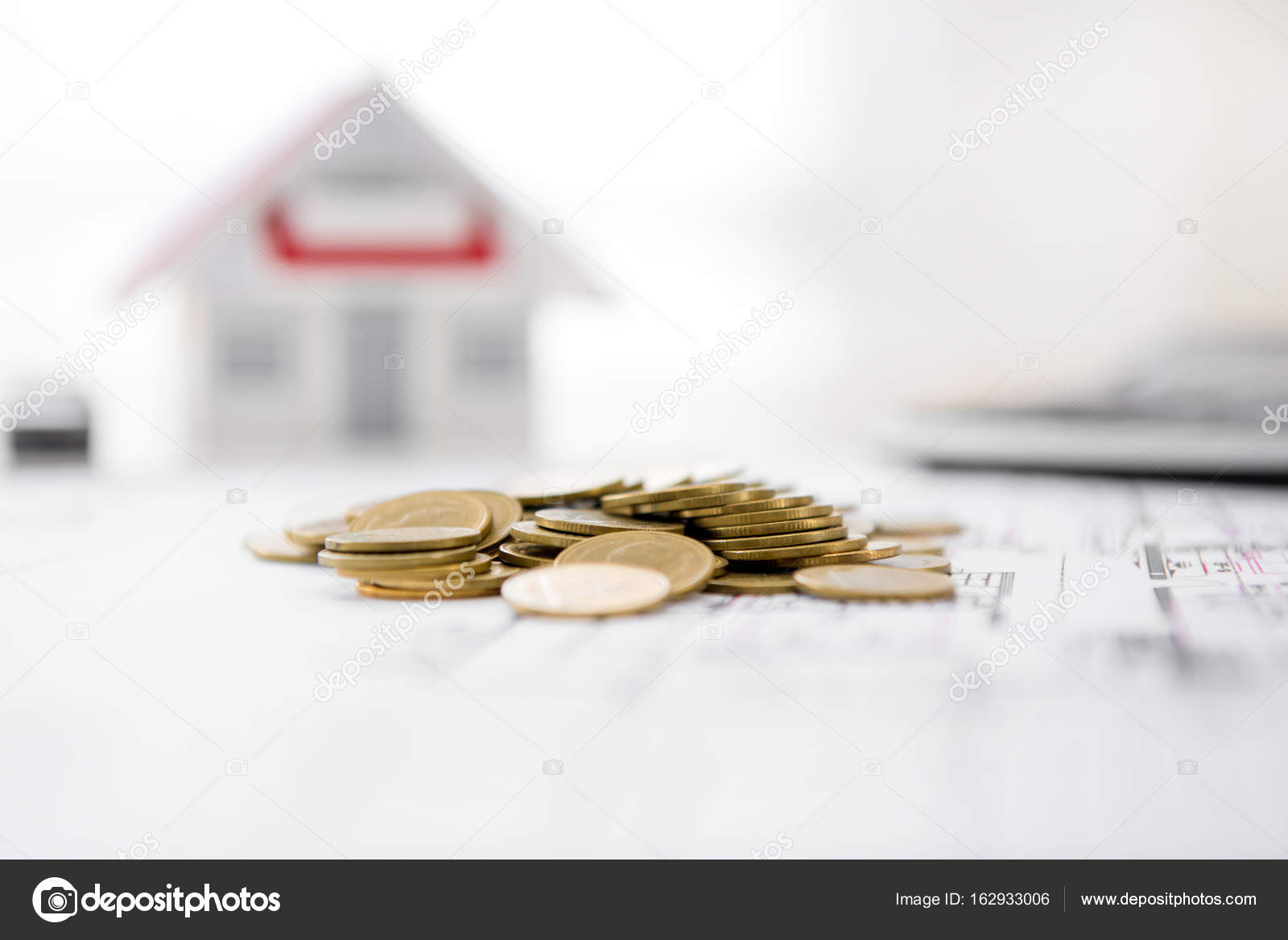 Money on blueprint paper with blurred house model in background money on blueprint paper with blurred house model in background real estate loan and financial concepts photo by kritchanut malvernweather