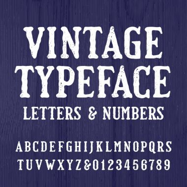 Vintage typeface. Retro alphabet font. Type letters and numbers on a rough wooden background.