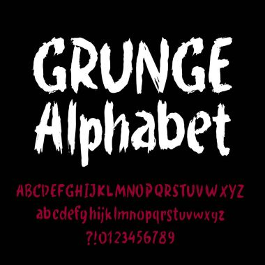 Grunge alphabet font. Hand drawn letters and numbers on a black background. Stock vector typeface for your headers or any typography design.