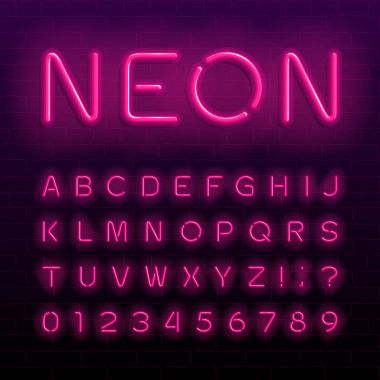 Neon lamp alphabet font. Neon color shiny letters, numbers and symbols. Brick wall background. Stock vector typeface for any typography design.