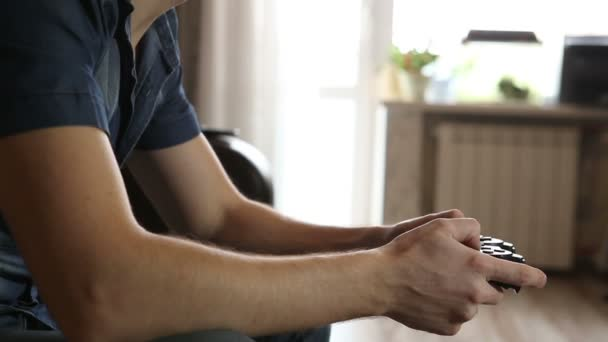 man playing a video game. with a gamepad hand closeup