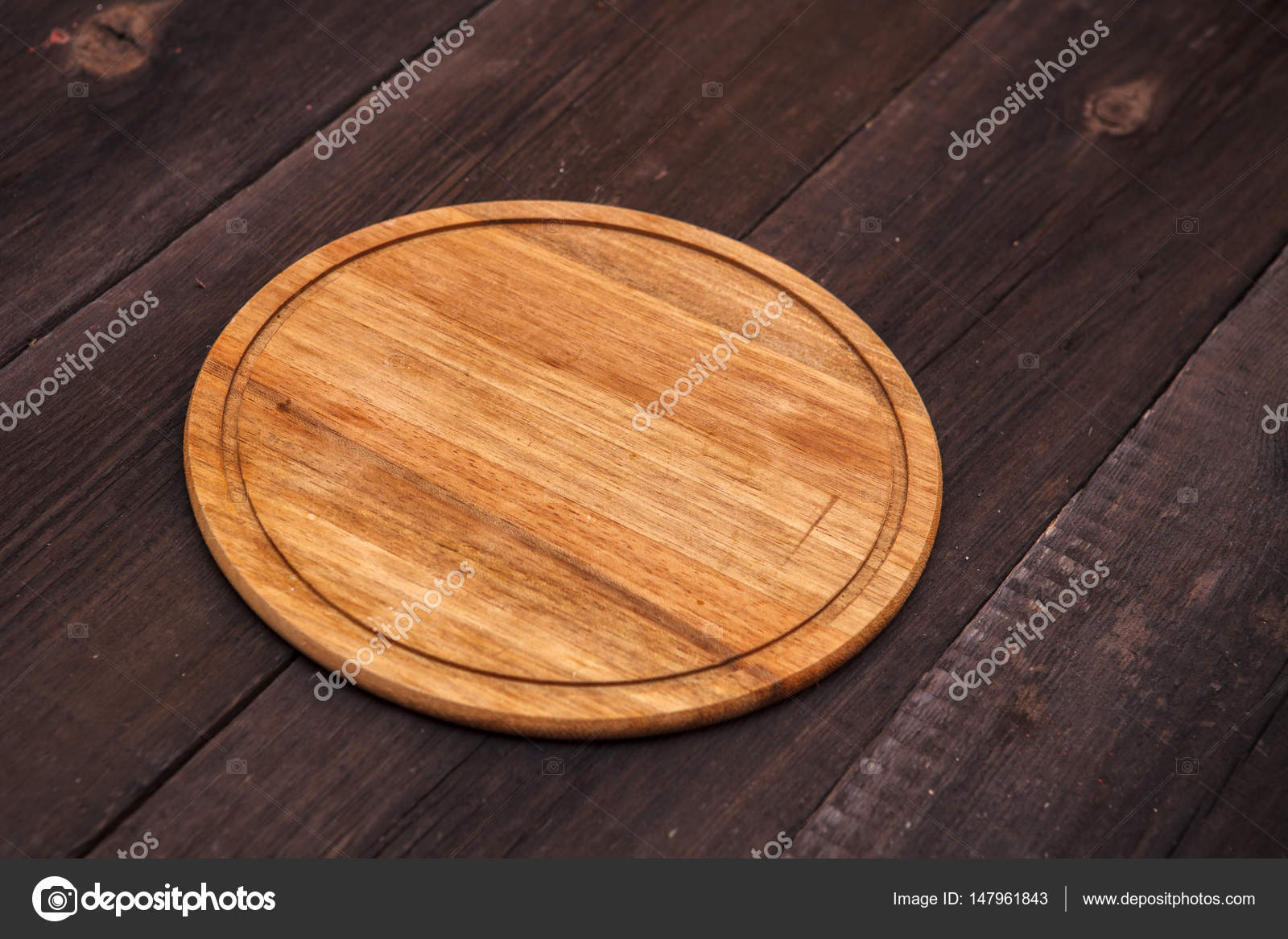 Round Wooden Cutting Board On A Wooden Background Stock Photo C Toomler 147961843