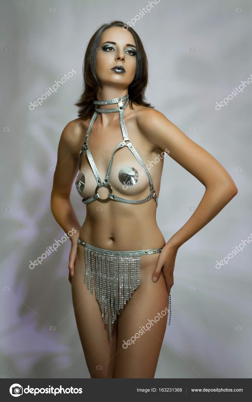 A Charming Sexy Girl With Loose Hair With Body Art In The