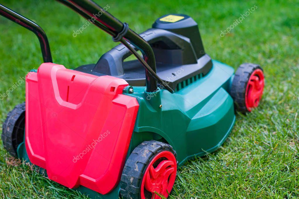 Lawn mower in the backyard