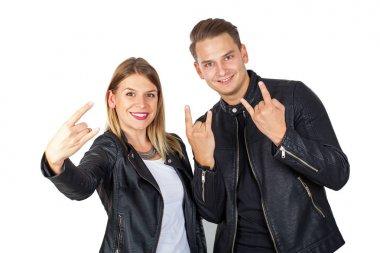 Stylish couple shwoing rock & roll