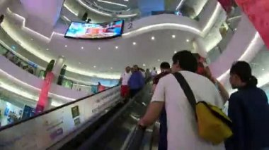 Bangkok, Thailand - March 5, 2018 : Unidentified people walk and move on escalators inside the Siam Paragon Shopping mall
