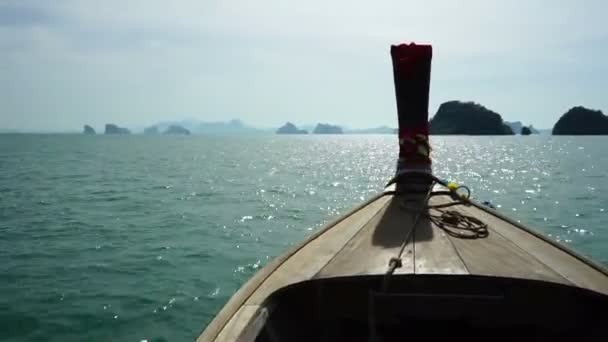 Front view of wooden long tail boat