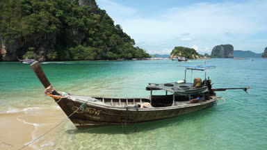 Krabi, Thailand - April 15, 2018 : Long tail boat on the beach at Krabi