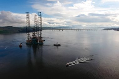 Towing of the oil platform. Drilling platform in the port.