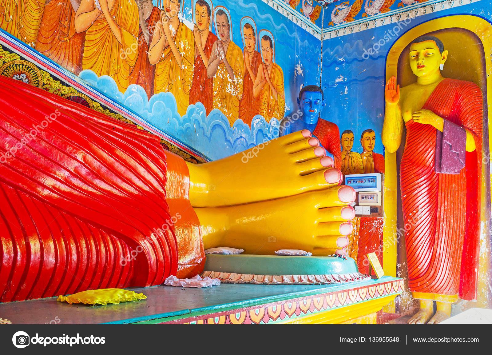 The symbolism in buddhist temple stock editorial photo anuradhapura sri lanka november 26 2016 the legs of reclining buddha statue blue buddha in corner known as statue of of medicine or healing and buycottarizona