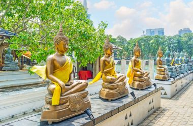 The golden Buddha statues in Colombo