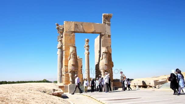 PERSEPOLIS, IRAN - OCTOBER 13, 2017: All Nations Gate (Xerxes Gate) with preserved statues, decors and columns is one of most popular landmarks of archaeological site, on October 13 in Persepolis.