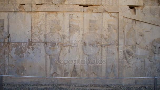 PERSEPOLIS, IRAN - OCTOBER 13, 2017: The relief on Eastern Stairway of Apadana palace in Persepolis depicts the soldiers of elite corps, known as Immortals, on October 13 in Persepolis.