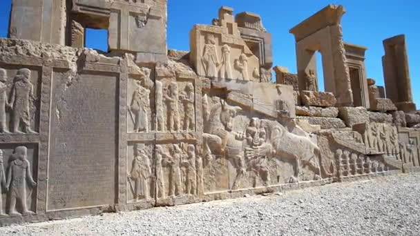 Persepolis archaeological site boasts preserved reliefs, depicting classical scenes, such as lion biting the bull, ancient soldiers, courtiers or bearers, Iran.
