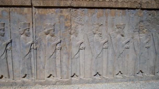 PERSEPOLIS, IRAN - OCTOBER 13, 2017: The relief on wall of Eastern Stairway of Apadana palace in Persepolis depicts the couriers of Persian ruler, on October 13 in Persepolis.