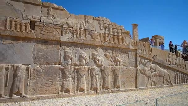 The ruined palaces of Persepolis archaeological site boast preserved relief decors, such as the facade wall of palace of Xerxes (Hadish), Iran.