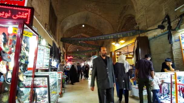 KERMAN, IRAN - OCTOBER 15, 2017: The Grand Bazaar is the noisy and crowded place, locals and tourists walk here in the evenings, choosing interesting goods and souvenirs, on October 15 in Kerman.
