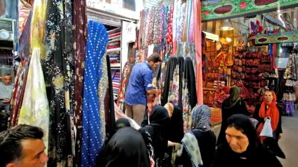 SHIRAZ, IRAN - OCTOBER 14, 2017: Textile department of Vakil Bazaar is always busy and crowded, locals and tourists try to find interesting fabrics, on October 14 in Shiraz.