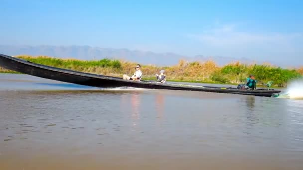 INLE LAKE, MYANMAR - FEBRUARY 18, 2018: Boat trips on Inle lake are very popular tourist attractions, people discover local agriculture, handicraft and old landmarks, on February 18 in Inle lake.