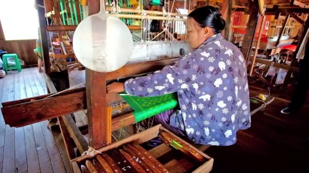 INLE LAKE, MYANMAR - FEBRUARY 18, 2018: Textile workshops on Inle lake are famous for the high quality handmade fabrics of cotton, silk and lotus, produced by locals, on February 18 in Inle lake.