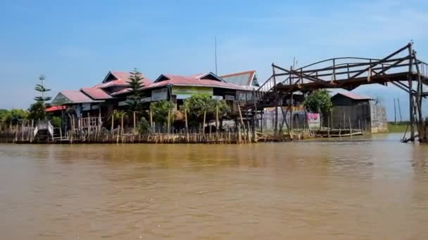 INLE LAKE, MYANMAR - FEBRUARY 18, 2018: Discover fishing villages, floating farms and traditional handicraft workshops on the banks of Inle lake, on February 18 in Inle lake.