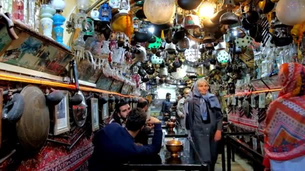 ISFAHAN, IRAN - OCTOBER 21, 2017: Interior of Azadegan teahouse - famous place located in Naqsh-e Jahan square, with unique interior decoration - collection of bric-a-brac, on October 21 in Isfahan.